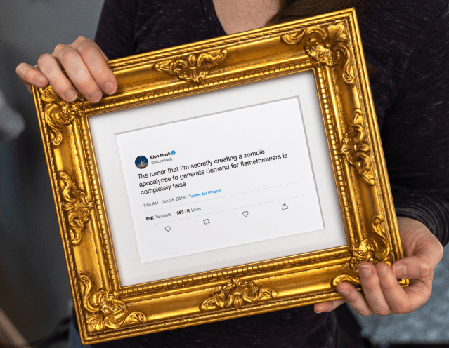 Framed Tweet held in hands