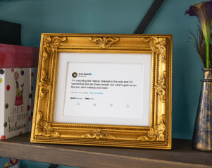 Framed Tweet standing on a counter