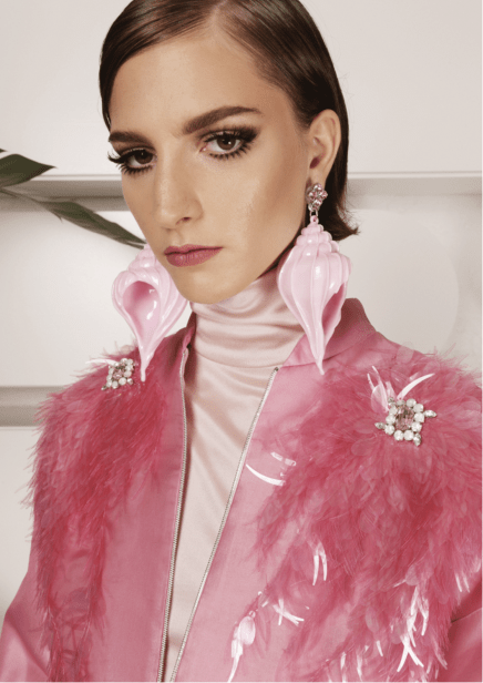 Model wearing pink 3d printed earrings