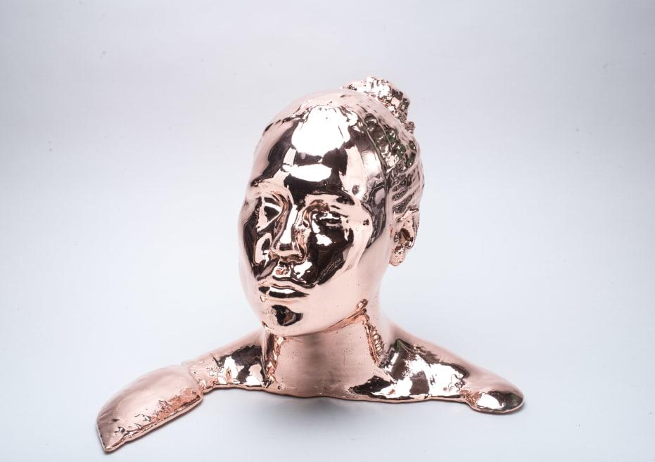 Metal plated head