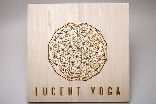 Laser cut lucent yoga logo