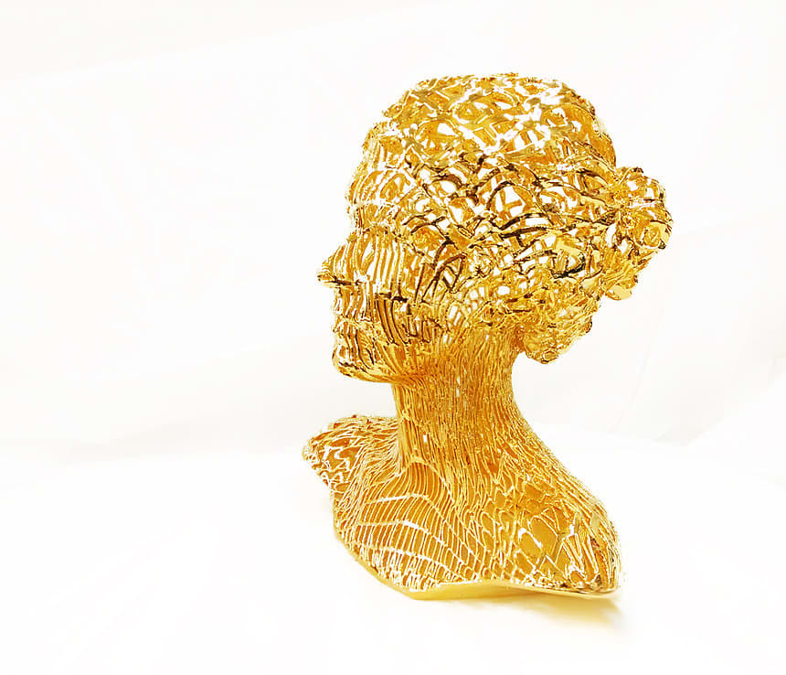 Gold plated lady gaga sculpture