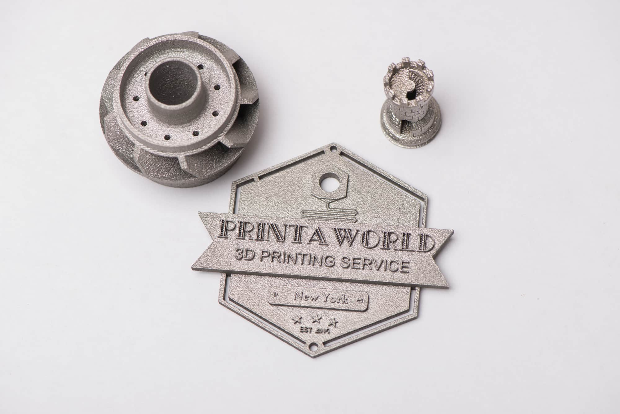 Printaworld logo metal plated