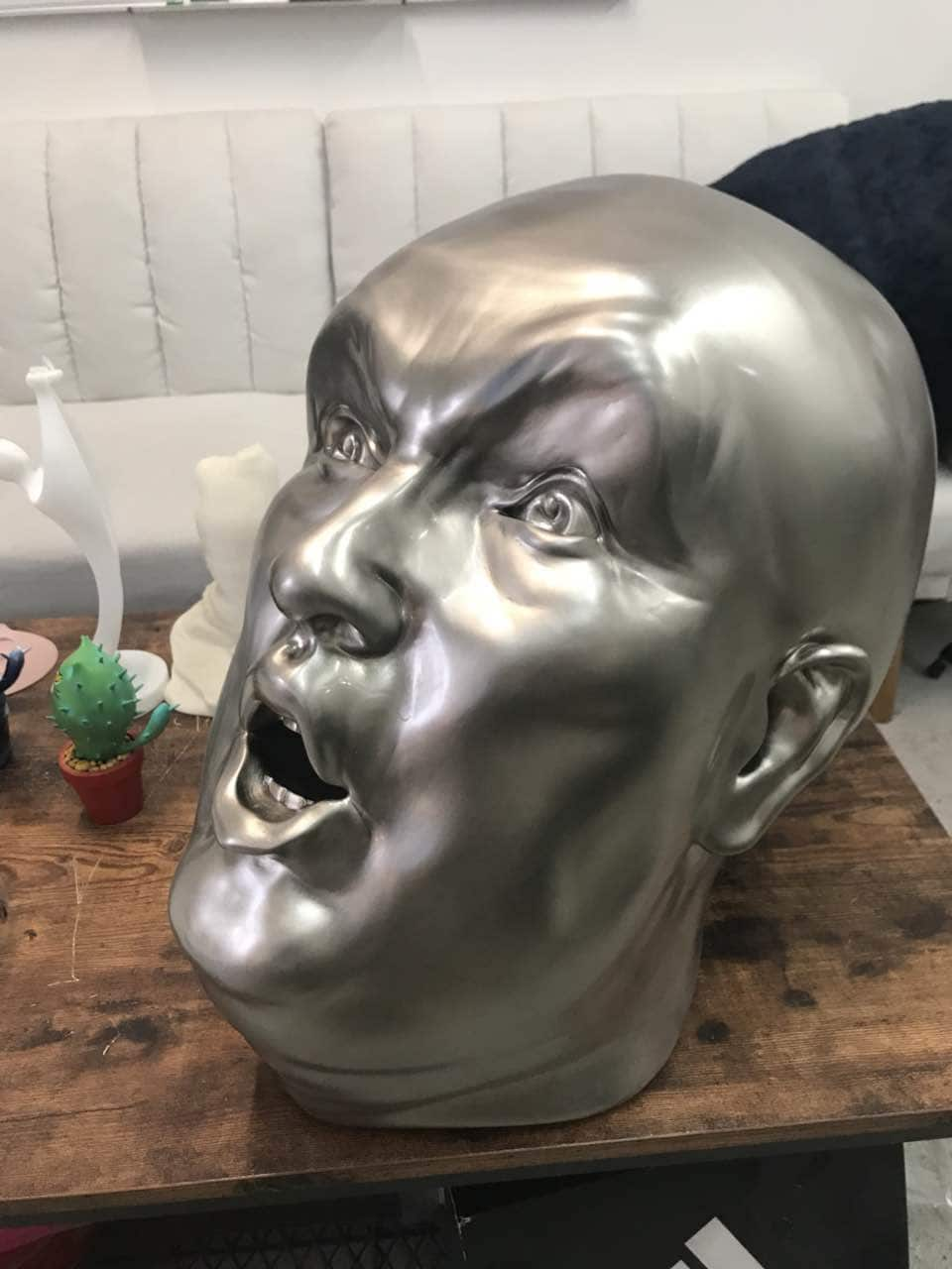 Metal plated Donald Trump head