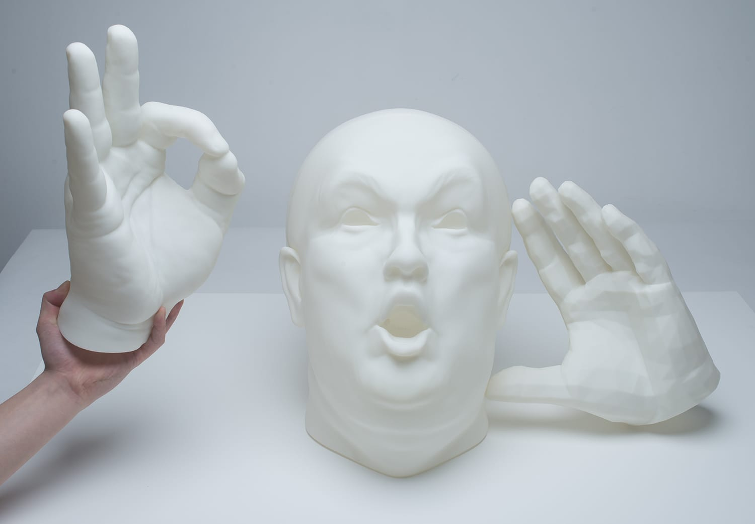 3d printed donald trump's head with hands on each side