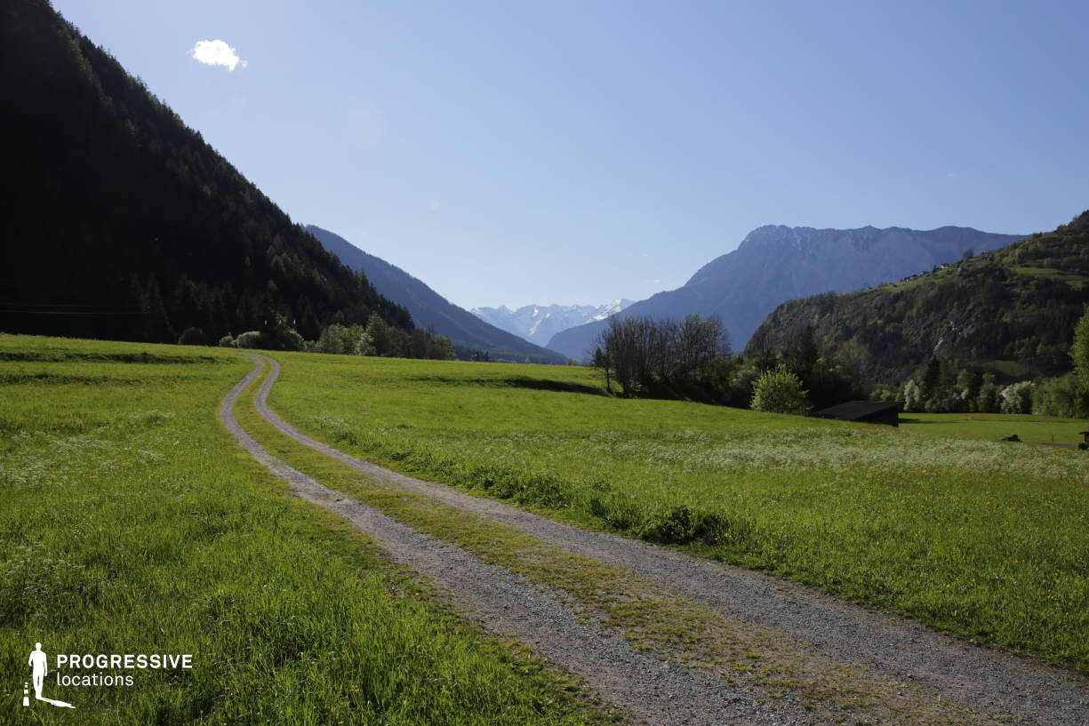 Locations in Austria: Meadow with Gravel Road, Oetz