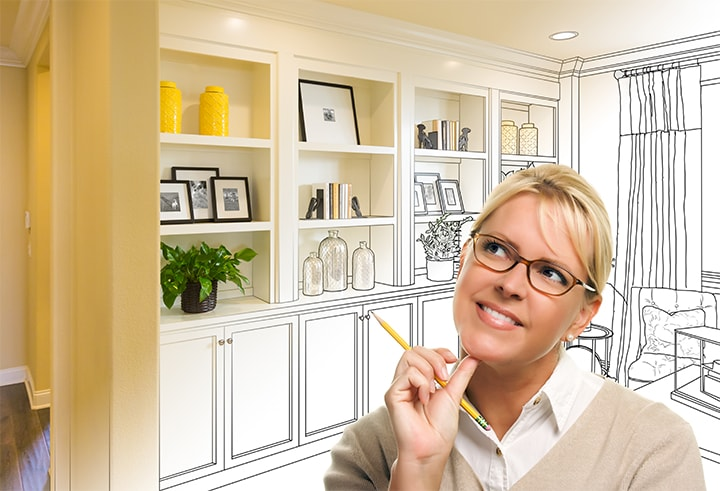 Home staging concept with woman imagining decor ideas.