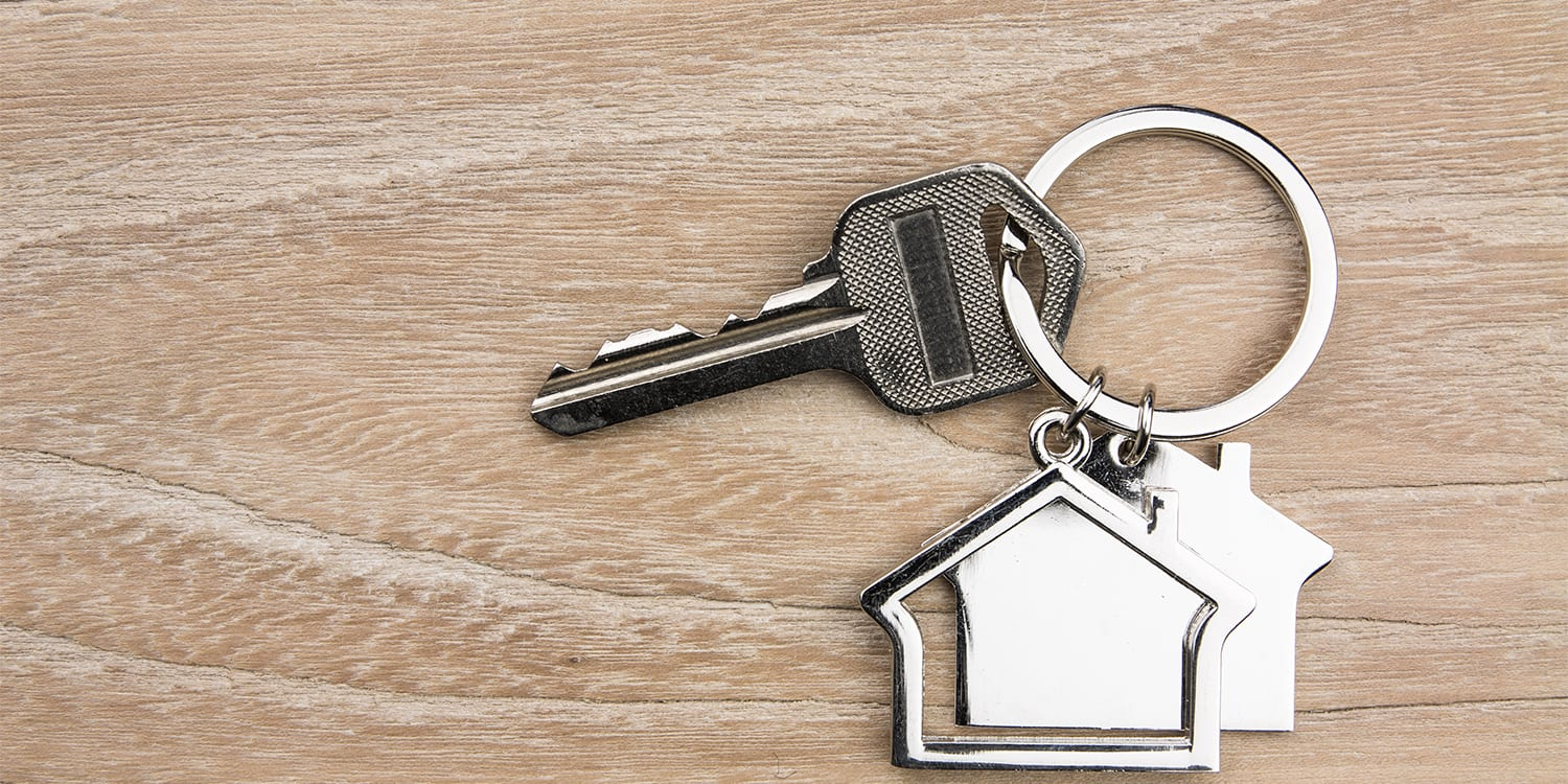 House keys on a table to conceptualize home sale