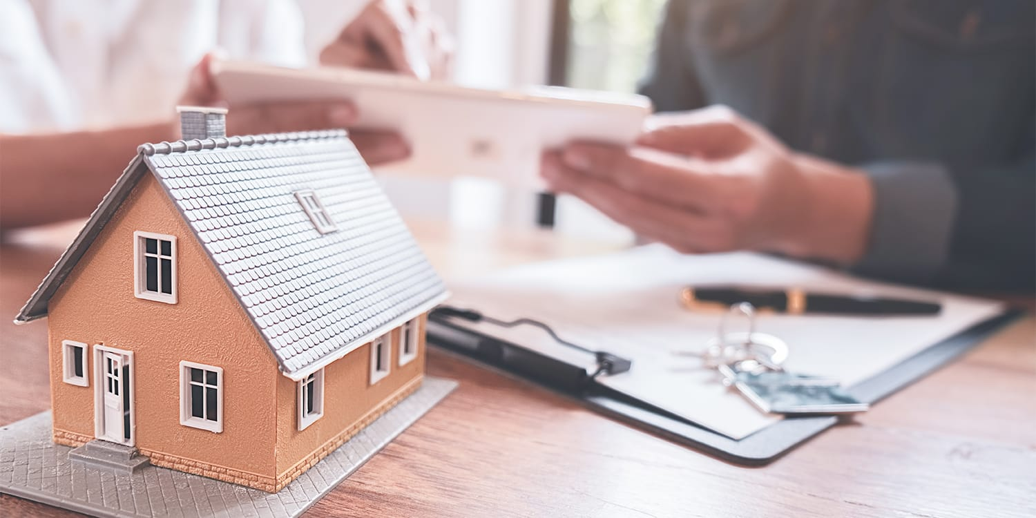 Couple reviewing property tax forms - tax default concept