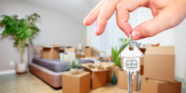 Home seller dangling keys in packed house.