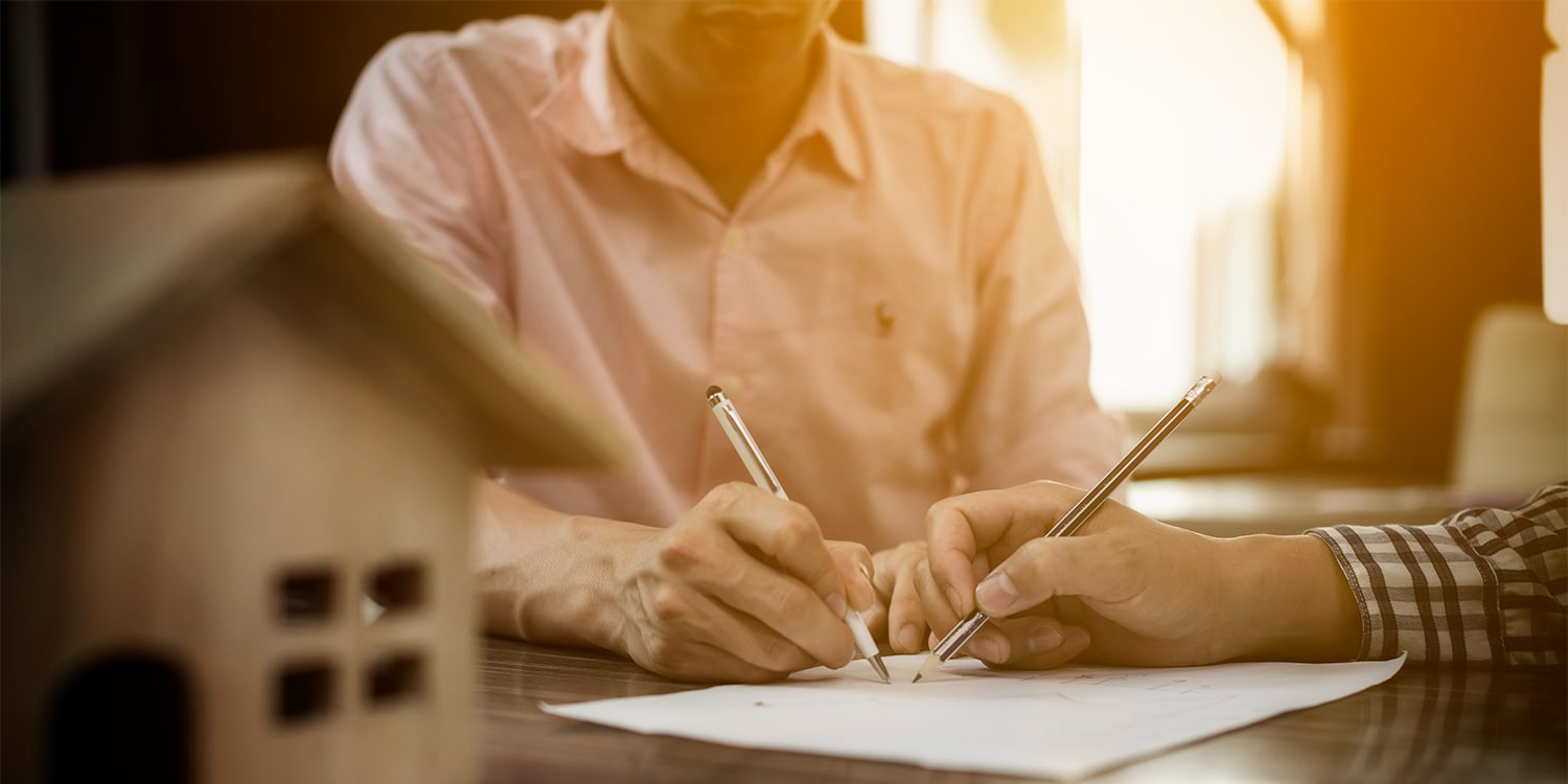 Couple selling house during divorce settlement
