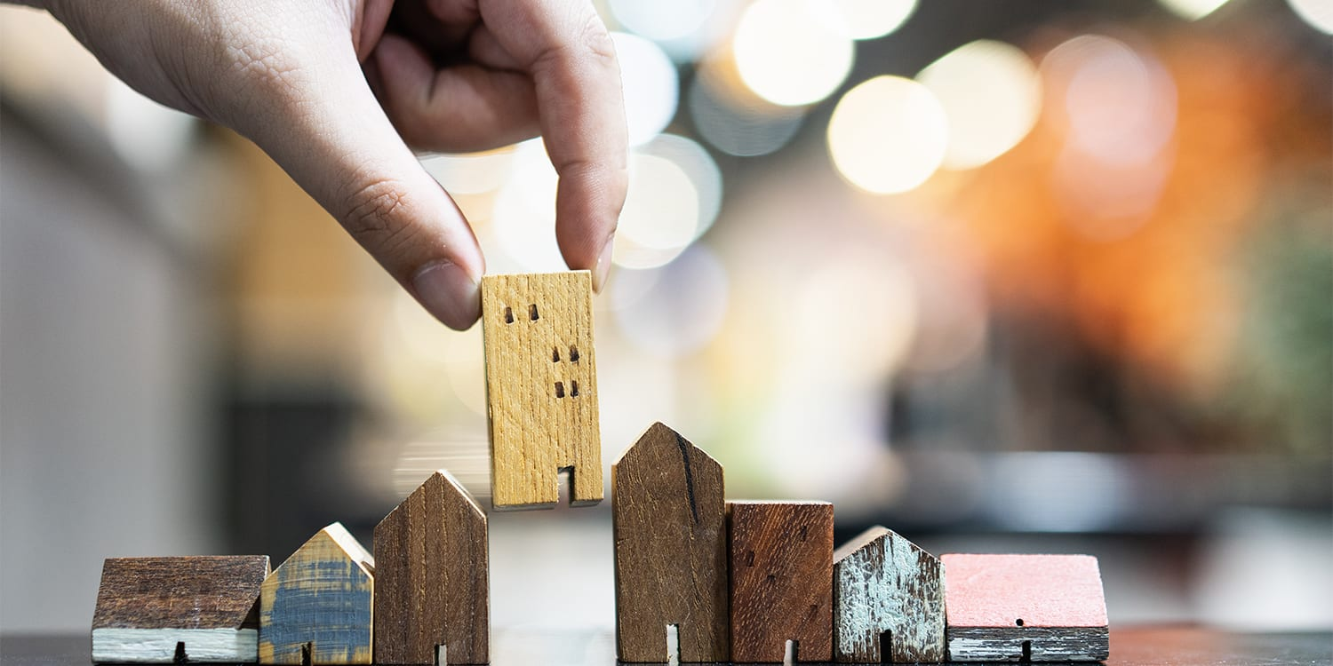 Row of block houses to represent real estate investment strategy
