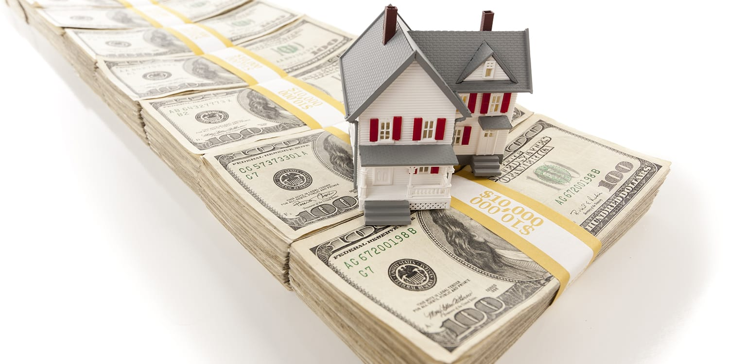 Cash home sale - house on top of money