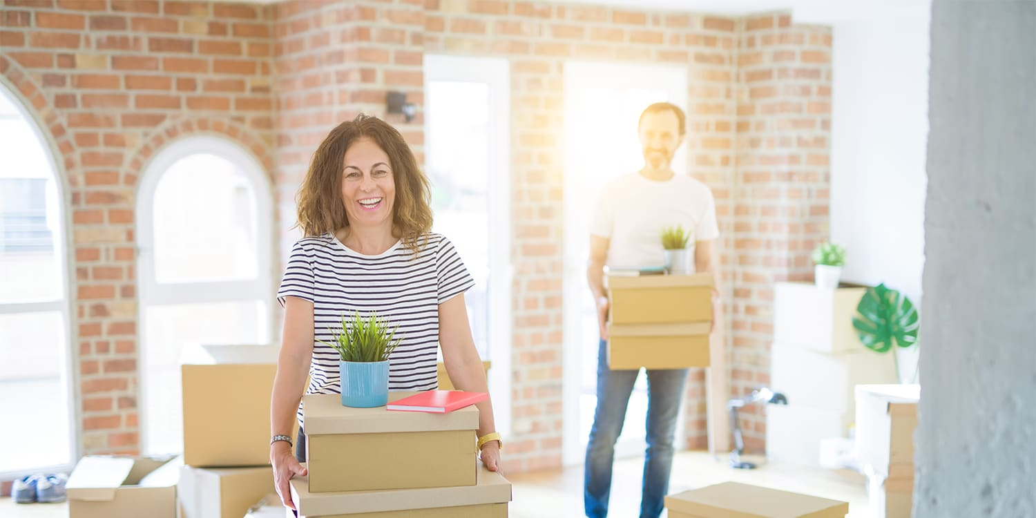 Happy couple moving for job relocation