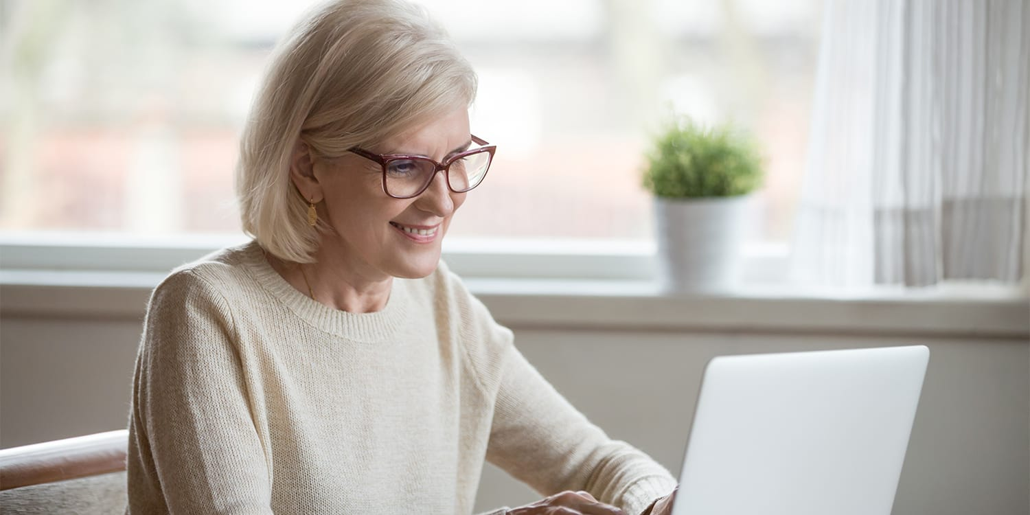 Female real estate investor working on computer