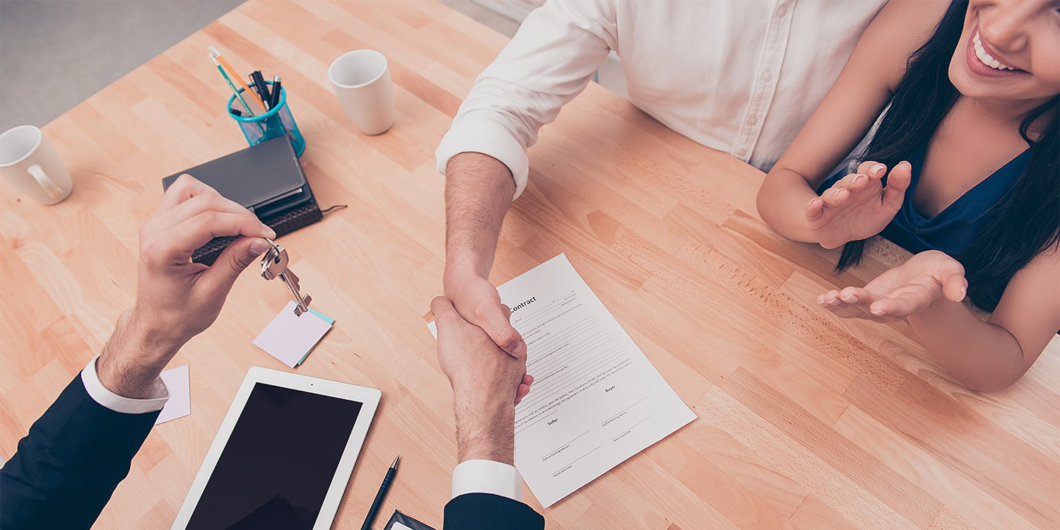 Home sellers closing a deal with an investor