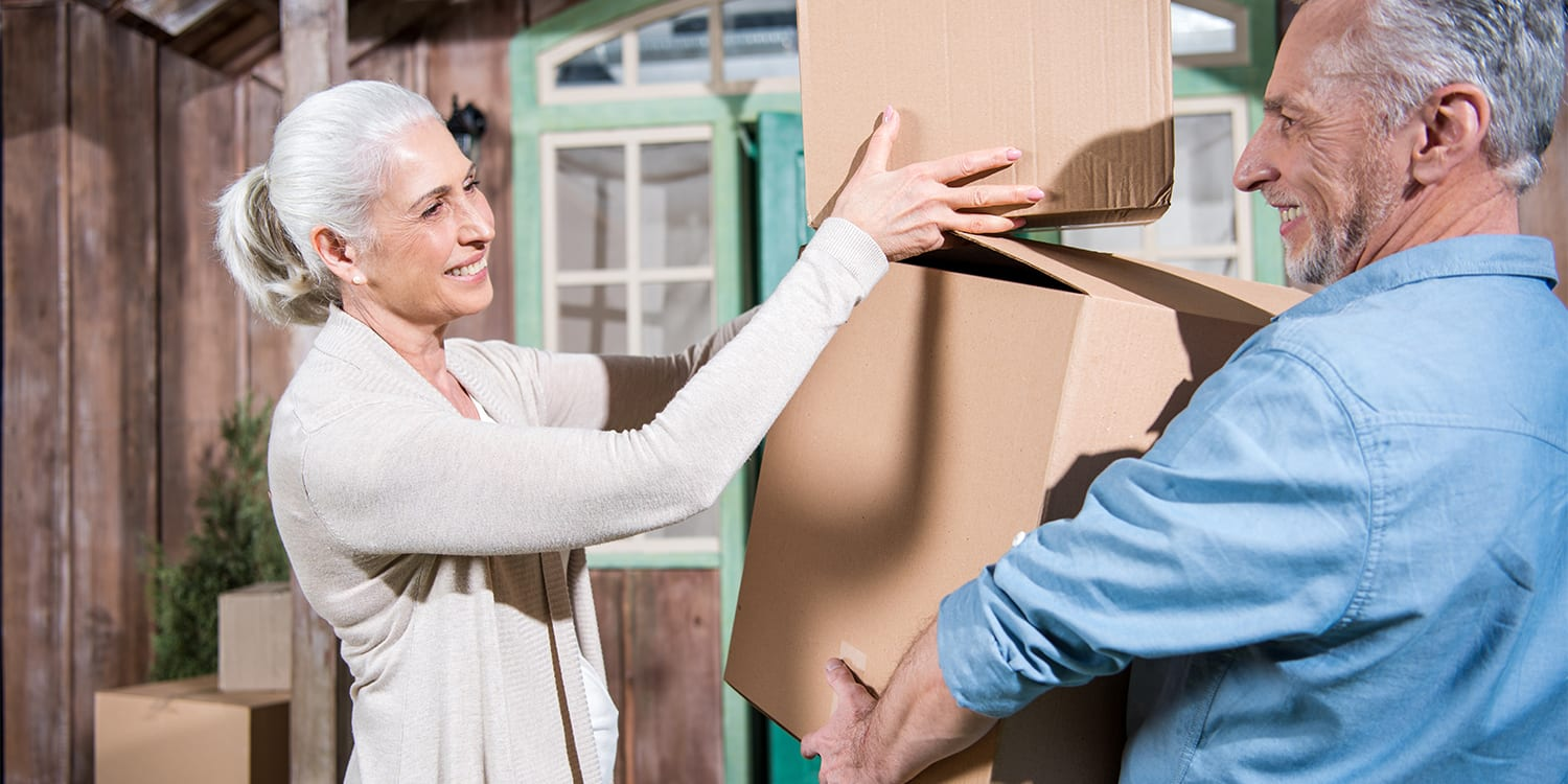 Older couple moving out of house.