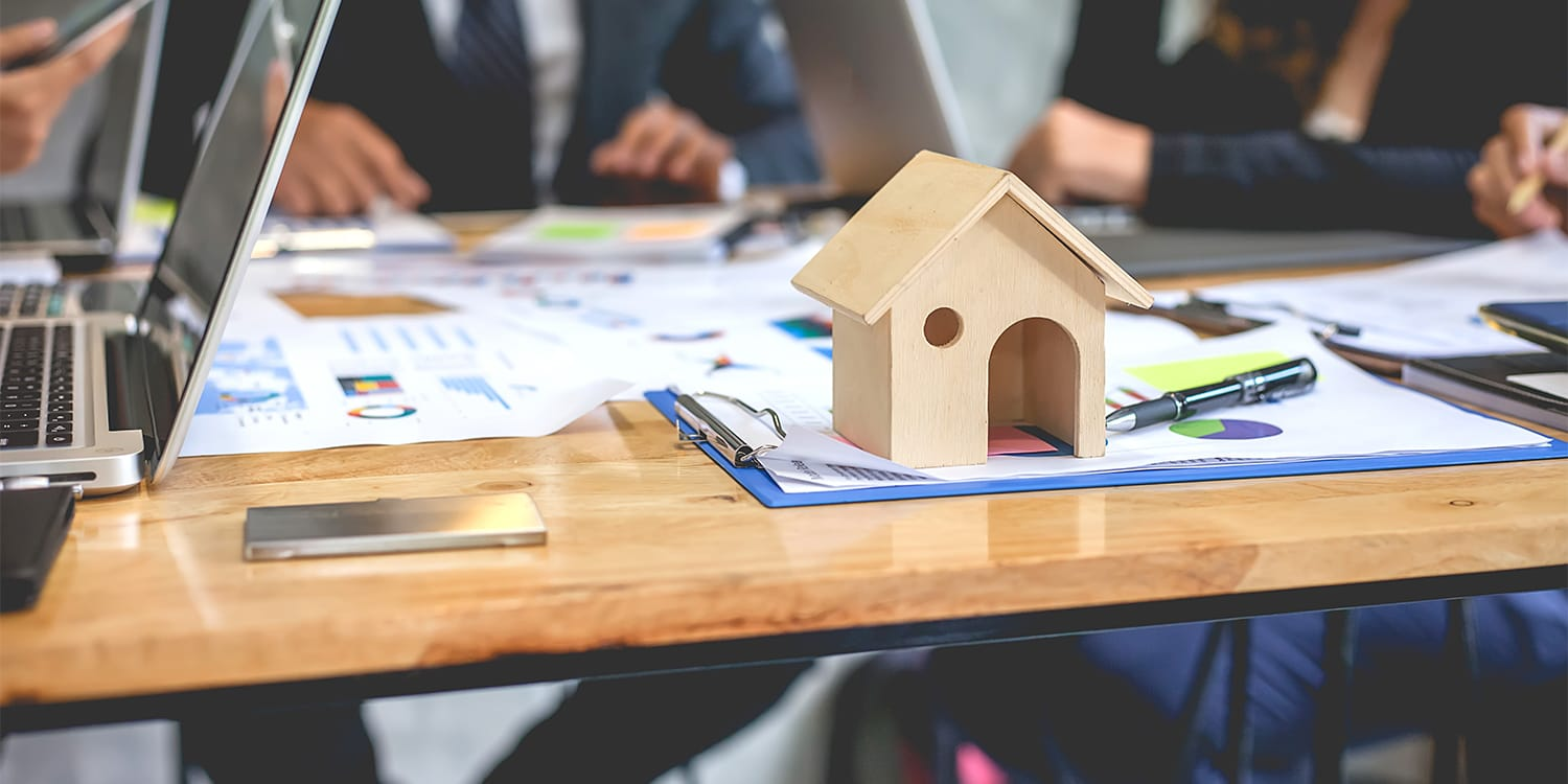 Real estate investors around table forming home buying network