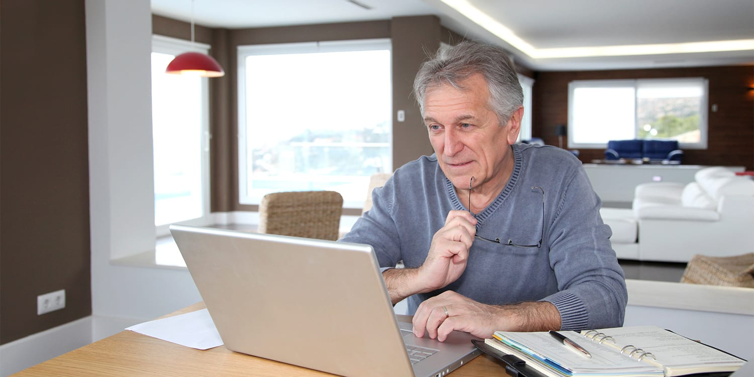 Man looking at computer, getting cash offer from PropertyLark