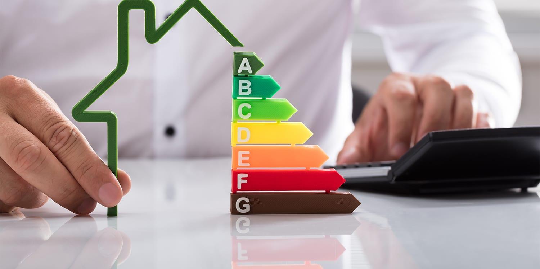 Real estate investor planning energy efficient house renovation.