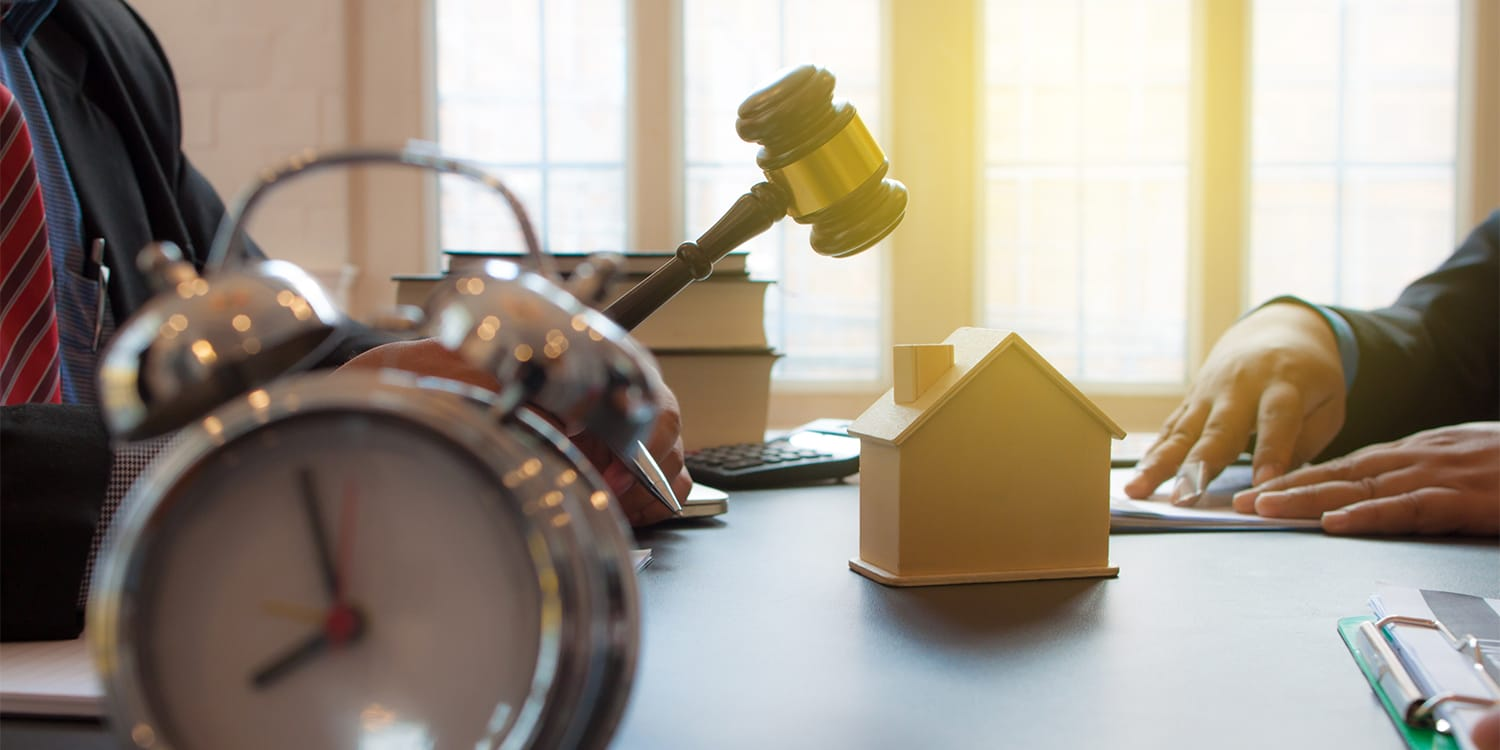 Real estate investor buying foreclosed homes