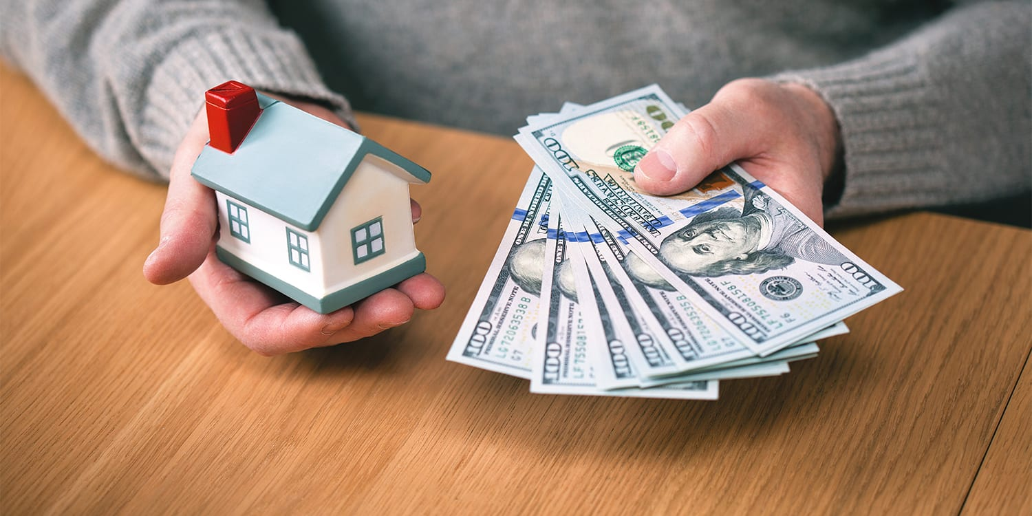 Person buying a house with cash