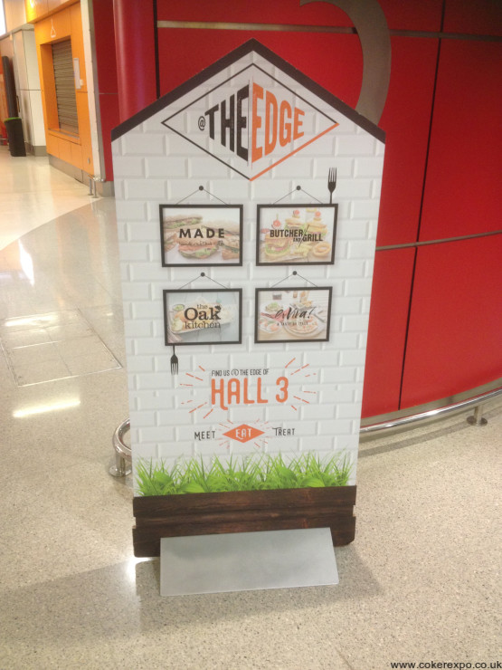 Cut out shape display in a wedge sign base unit