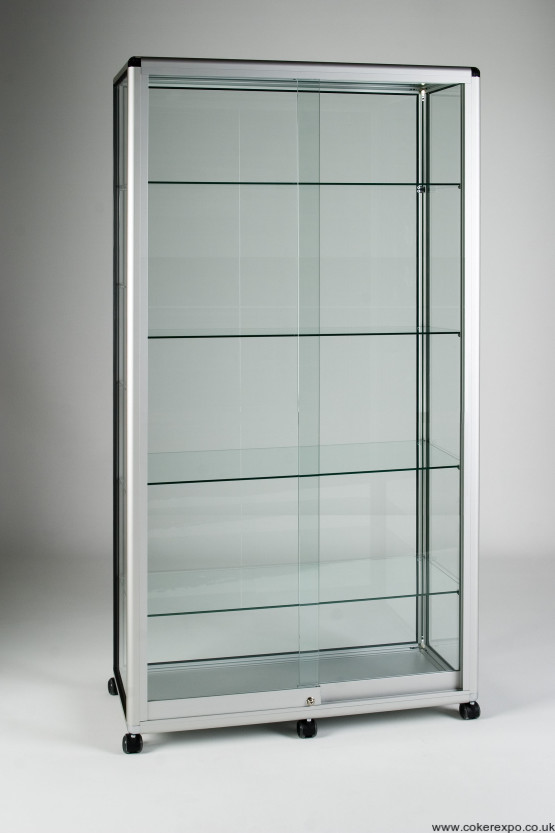 A double width glass display tower with 4 shelves and stud feet.