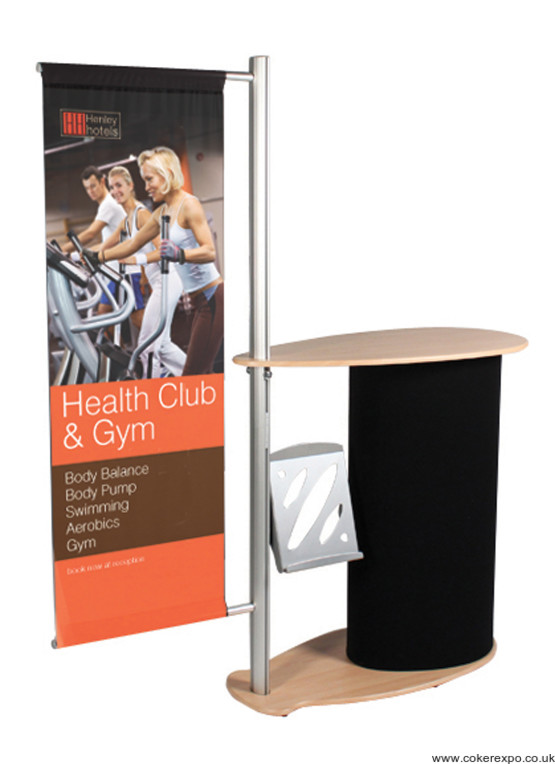 Comet exhibition counter with literature rack and graphic banner.