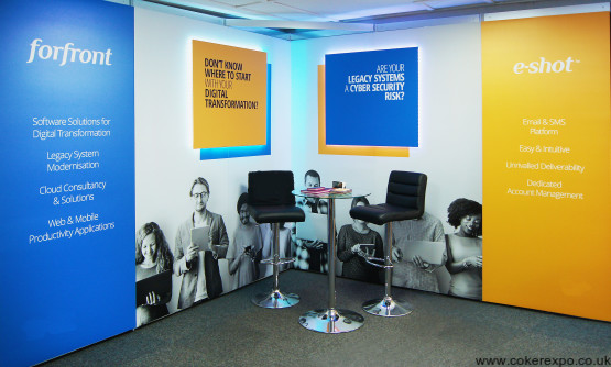 A shell scheme booth clad with graphics