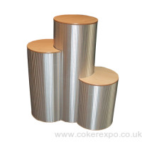 Brushed aluminium crescent plinth set arrangement