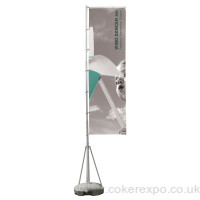 A portable telescopic flag pole for outdoor events.