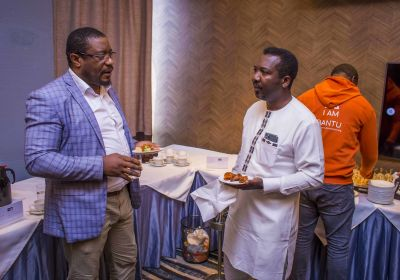 Chatting away is fun with 'small chops'. L - Adviser Chuta Chimezie and R - Ernest Mbenkum.