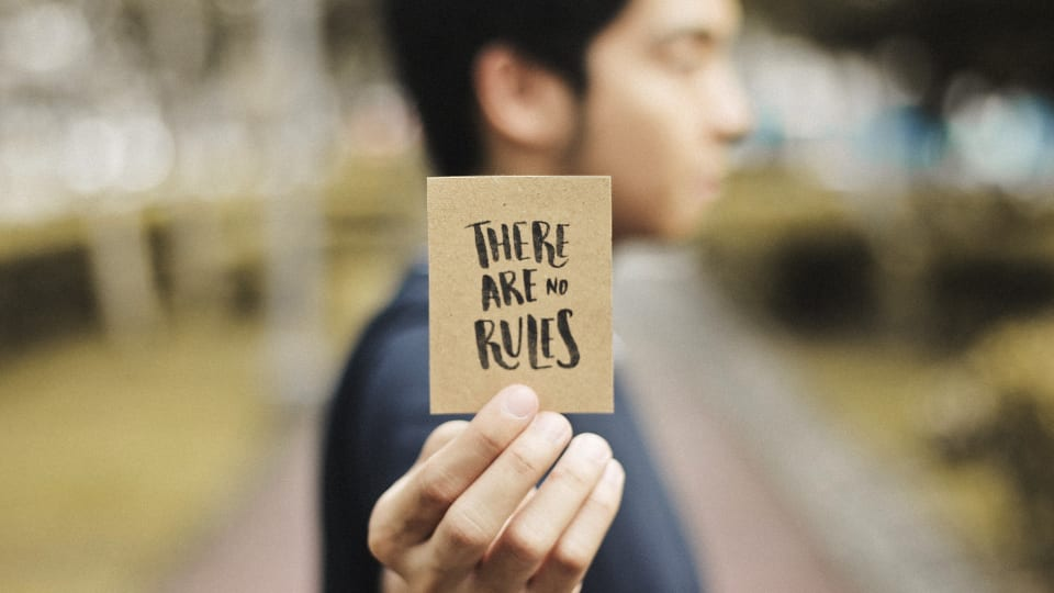 Someone holds up a card that says - 'There are no rules' on it
