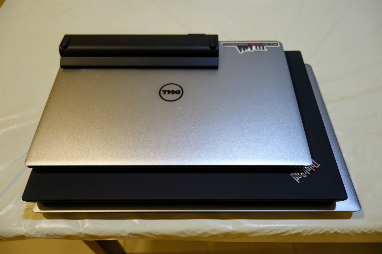 The XPS 15 9560, Thinkpad T480, and XPS 13 9343 on top of each other
