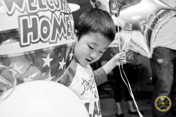 Portrait of a child's internaiton adoption homecoming