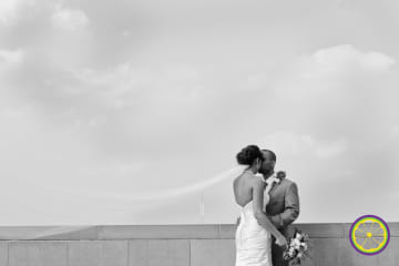 Romantic, grayscale photo of fashionable bride and groom kissing