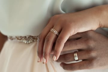 wedding rings on couple's hands in Saint Louis MO