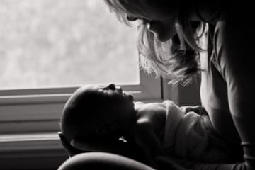"""Mother gazing into baby's eyes, with caption """"honor motherhood in the season where your feet fall now."""""""