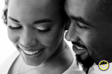 up close picture of bride and groom smiling