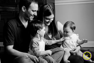 engaged family portrait sitting down with baby