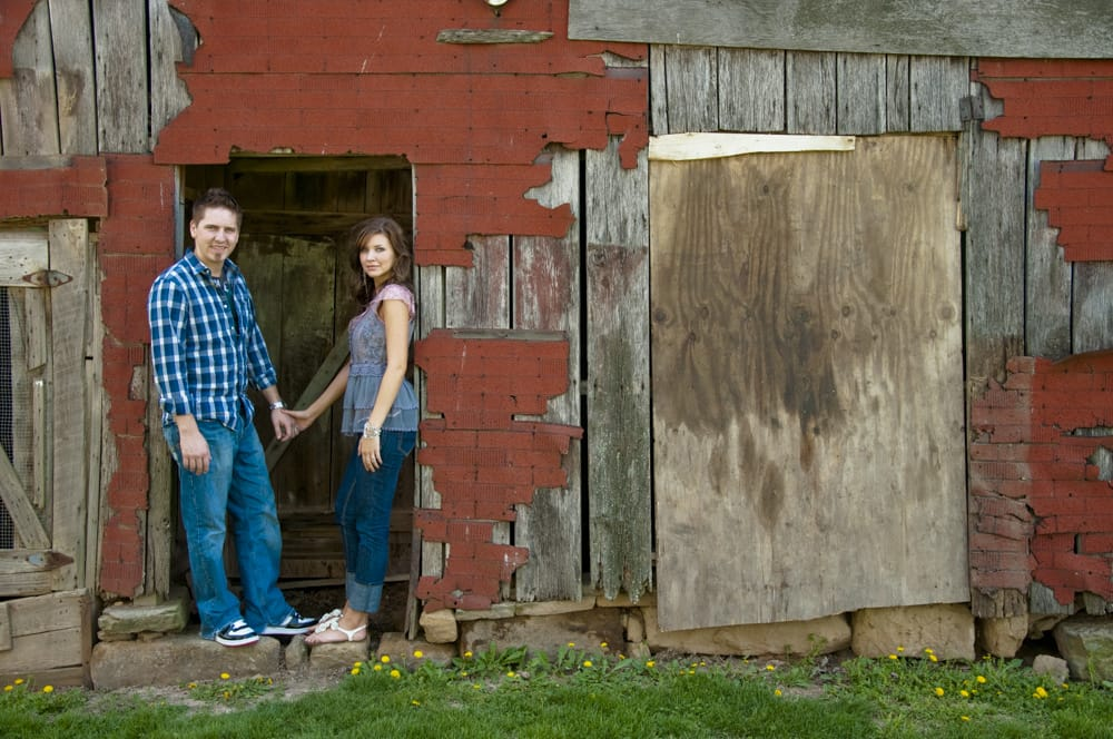 couple south of STL in family's red barn for enagement photo session