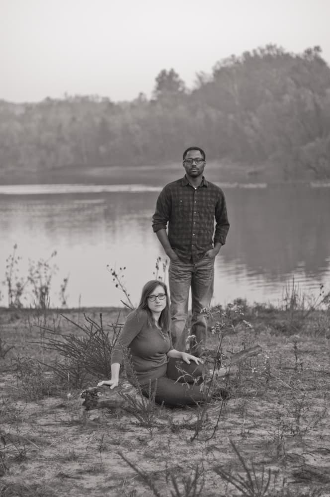 Black man and white woman posting by lake in autumn in St. Louis