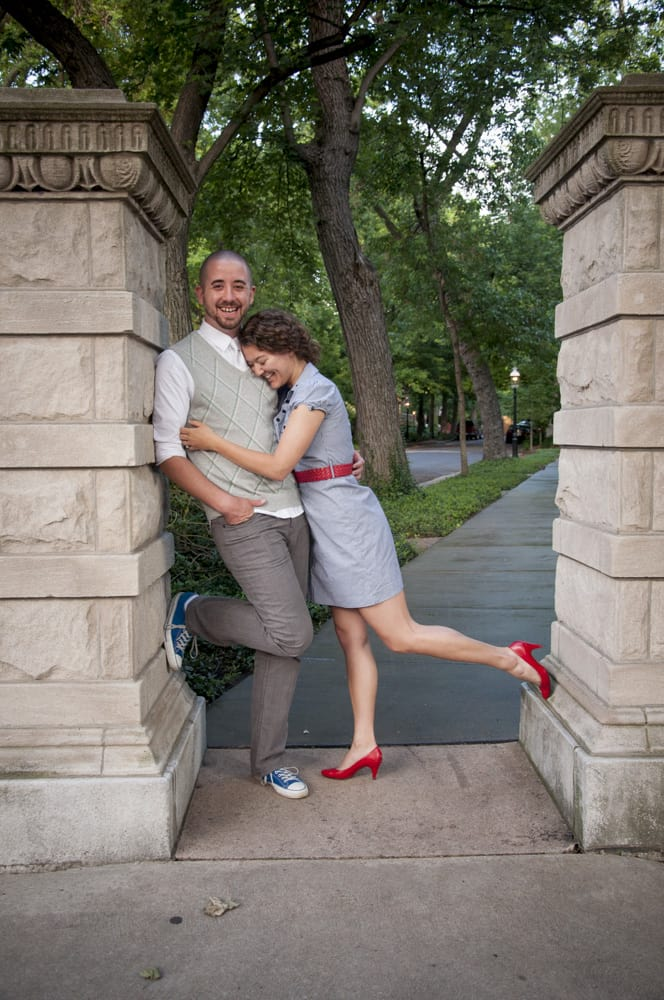 couple laughing and hugging in St. Louis for engagement pictures