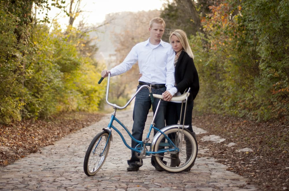 Engagement picure of couple with bike with banana seat