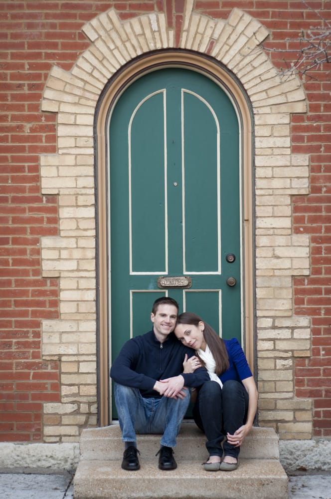 Couple in Lafayette Square in St. Louis MO sitting in arched door