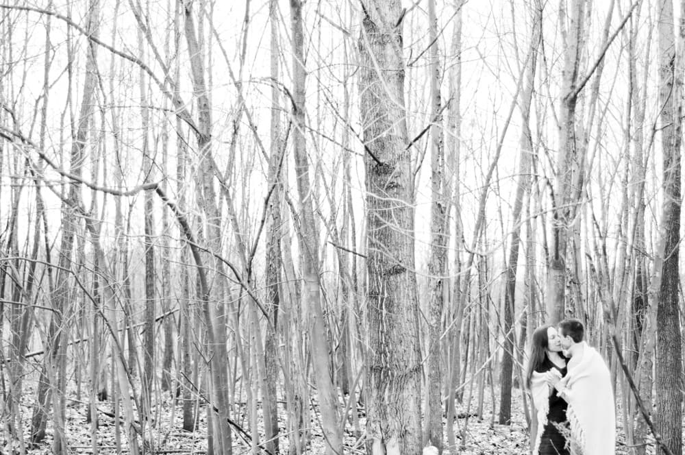 winter engagement pictures with bare trees and blanket in St. Louis MO