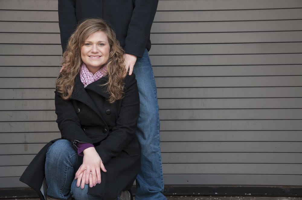 winter engagement couple picture with purple and neutral colors like gray and black near Clayton MO