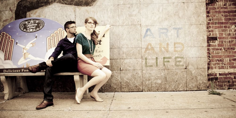 panoramic picture of a couple in downtown St. Louis with ART and LIFE grafitti and retro feel