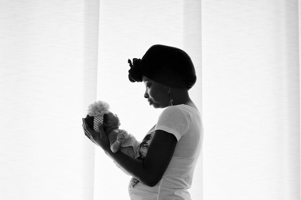 African American newborn baby and her mother shillouette picture